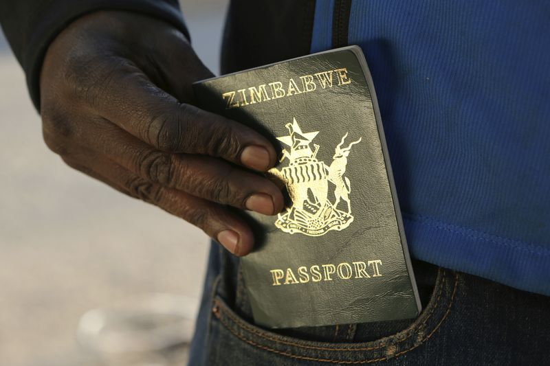 A man queues to submit an application for a new passport in Harare.