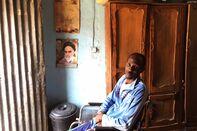 Former newspaper vendor Sharif Abu Bakr Zakariya sits in his wheelchair at home in the northern town ofKano on Feb. 10 asIran's first Supreme Leader Ayatollah Ruhollah Khomeini looks on.