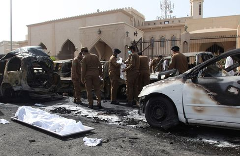 Saudi security forces inspect the site of a suicide bombing that targeted the Shiite Al-Anoud mosque in Dammam on May 29, 2015. Source: AFP/Getty Images