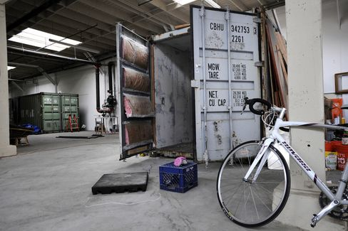 Shipping containers being converted into living spaces in an East Bay warehouse. Photographer: Michael Short/Bloomberg