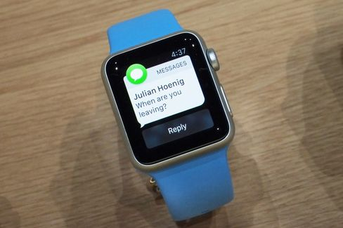 The aluminum Apple Watch Sport on a bright blue strap.