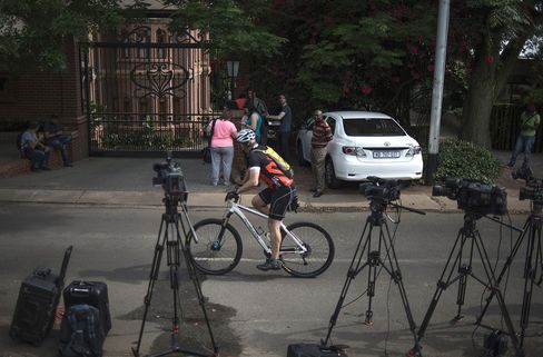 Journalists outside the home of Pistorius' uncle in Pretoria
