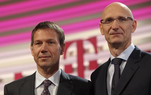 Deutsche Telekom CEO Rene Obermann and CFO Timotheus Hoettges