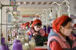 Workers of Songyo Knitwear Factory in Pyongyang produce masks for protection against the new coronavirus in this photo taken on Feb. 6, 2020.