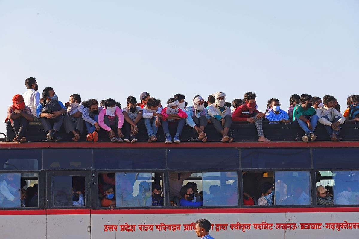 Truck Depots, Highways Checkpoints And Migrant Workers Walking on Foot As India Closes State Borders