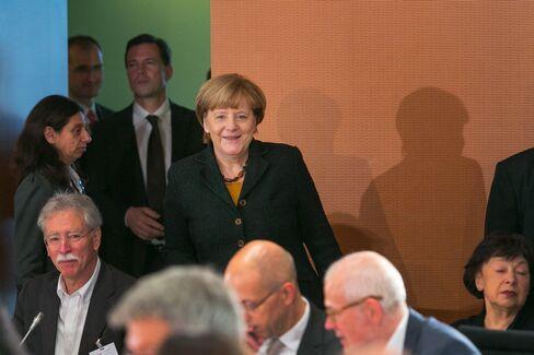 Angela Merkel arrives at immigration summit