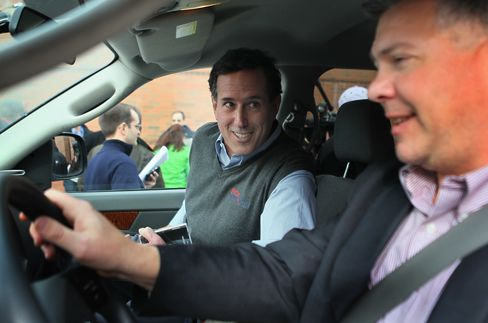Former Senator Rick Santorum gets into his campaign vehicle, a Dodge truck dubbed the 'Chuck Truck,' after a campaign stop at the Indianola Public Library on December 31, 2011 in Indianola, Iowa.