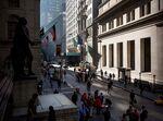Pedestrians walk near the New York Stock Exchange.