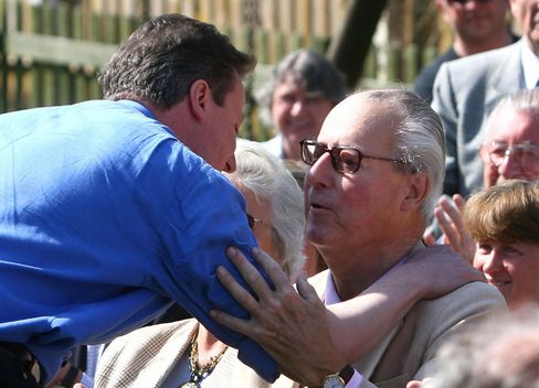 David Cameron greets his father Ian in 2010.
