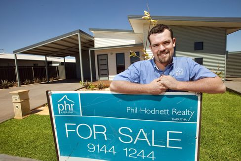 Real estate agent Phil Hodnett with home for sale