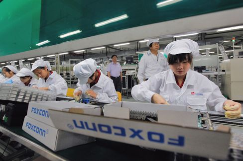 Foxconn Employees Work on the Production Line