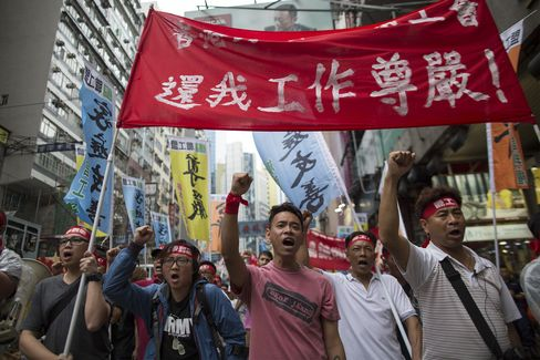 Li Ka-Shing's Dockers Accept Pay Offer to End Longest Strike