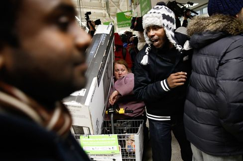 Customers scramble for Black Friday deals at an Asda supermarket in London on Nov. 28, 2014.