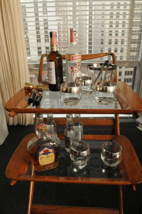 "Don's Italian-made bar cart—now at the Smithsonian—is higher than most, so the 6'2"" Jon Hamm didn't have to bend down to use it."