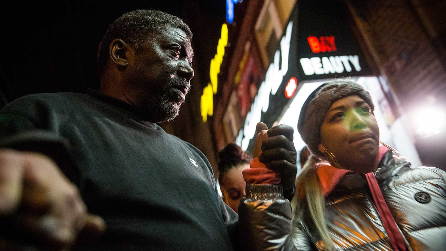 Benjamin Carr, stepfather of Eric Garner, prays on Dec. 3, 2014, outside the Staten Island beauty salon where his stepson was killed.