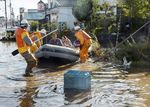 Fire department workers evacuate residents from a flooded area in Date, Fukushima prefecture on October 13, 2019, one day after Typhoon Hagibis swept through central and eastern Japan.