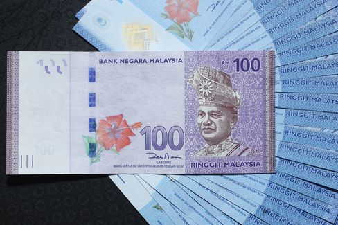 Ringgit Jumps Most Since 1998, Stocks Reach Record Post Election