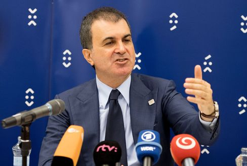 Omer Celik speaks to journalists in Bratislava on Sept. 3.