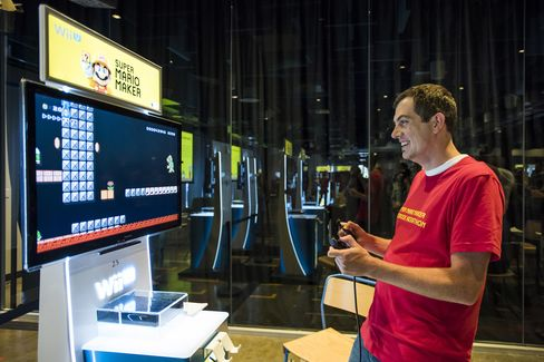 Nintendo employee Corey Olcsvary judges a newly created level for Super Mario Maker during a hackathon at the Facebook headquarters in Menlo Park, Calif., on July 29, 2015.