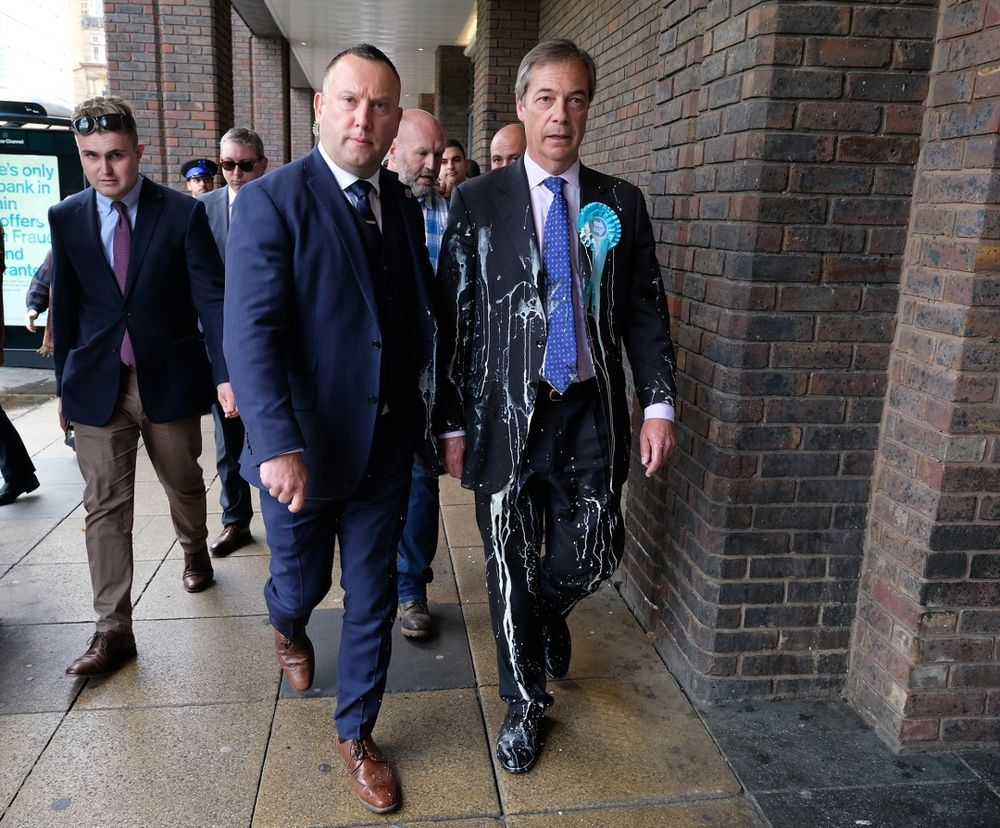 Nigel Farage Hit by Milkshake During Campaign Walkabout