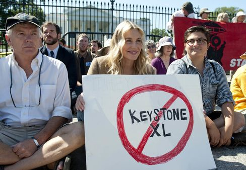 American actress Daryl Hannah sits in front of the White House during a protest against the construction of the Keystone XL pipeline.