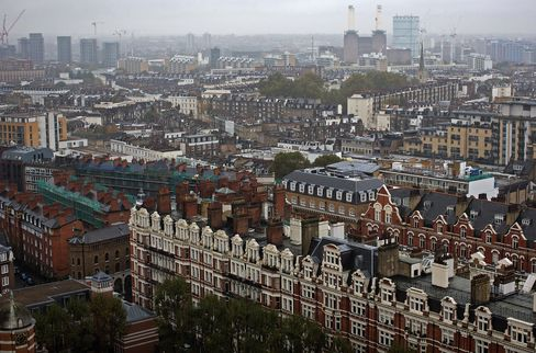 The Battersea power station residential development, right, stands on the horizon beyond rows of residential apartment blocks in the Westminster district of London, U.K., on Wednesday, Oct. 29, 2014.