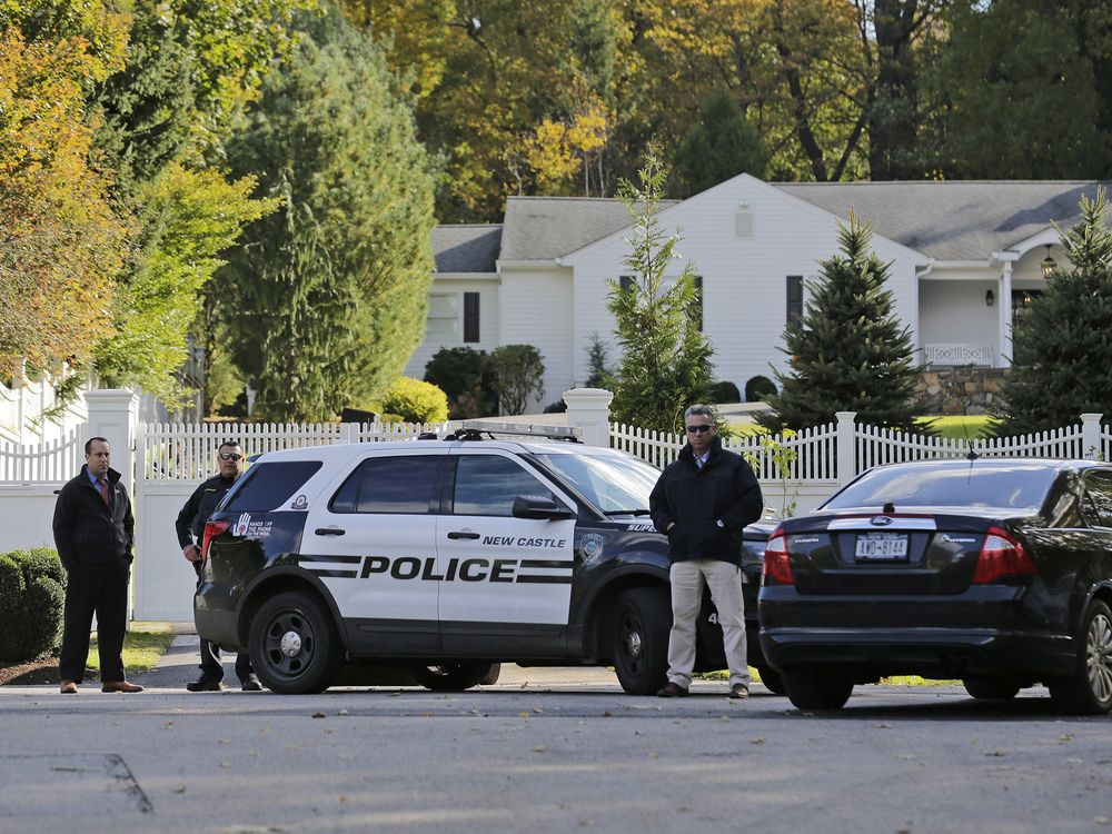 3e3b90415 Police officers outside the Clinton home in Chappaqua, New York on Oct. 24.