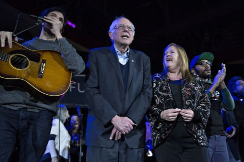"Bernie and Jane Sanders sing ""This Land is Your Land"" during a campaign rally at the University of Iowa Field House in Iowa City on Jan. 30, 2016."