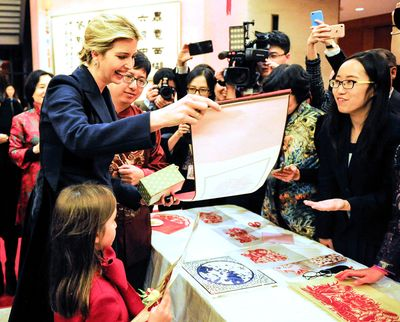 WASHINGTON, Feb. 2, 2017  -- Ivanka Trump (L), daughter of U.S. President Donald Trump, attends the Chinese Embassy's New Year reception with her daughter (front L) in Washington, D.C., the United States, Feb. 1, 2017. China and the United States should always cooperate in the face of challenges, Chinese Ambassador to the United States Cui Tiankai said Wednesday. (Xinhua/Liu Yang)