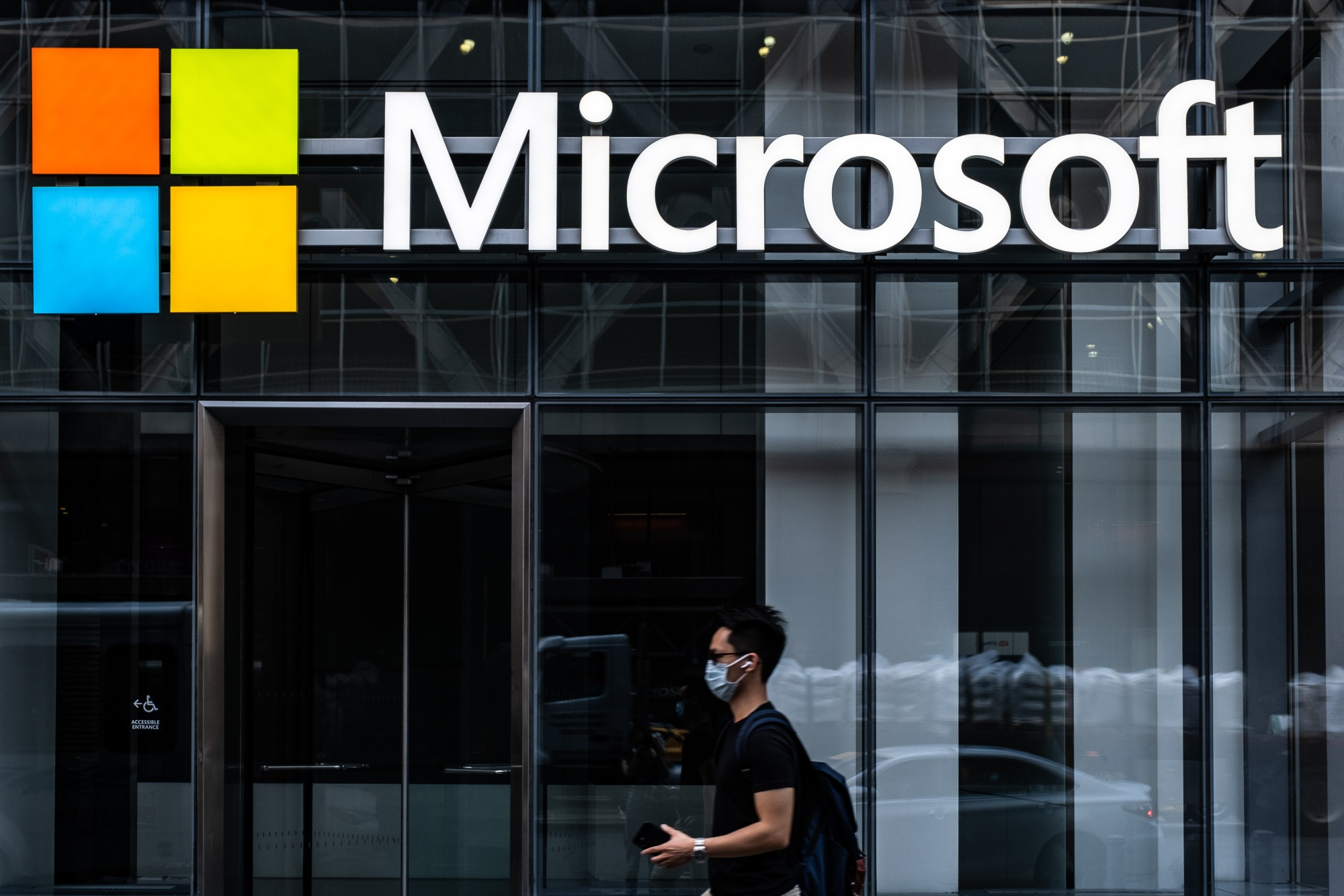 A pedestrian wearing a protective mask walks past a Microsoft Technology Centers in New York, U.S., on Wednesday, July 22, 2020.