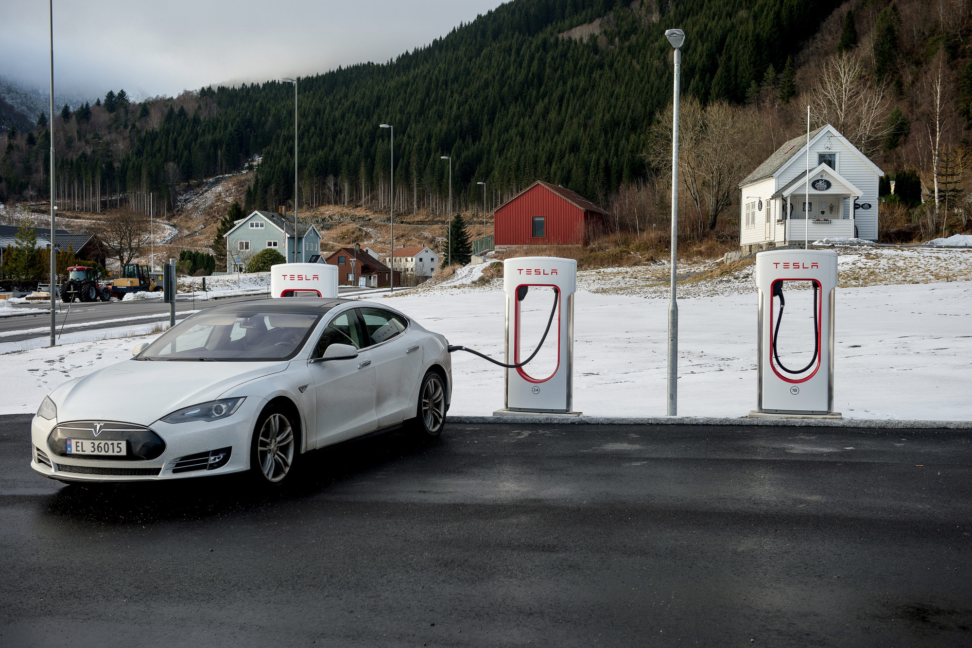 A Tesla automobile stands charging at a Tesla Inc. charging station in Lavik near Bergen, Norway.