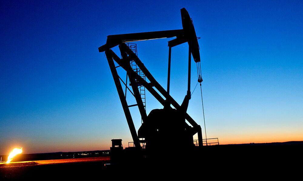 Oil Near $60 as Stockpiles Drop, Saudis Cut Supply