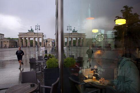 Customers Sit Inside a Coffee Shop in Berlin