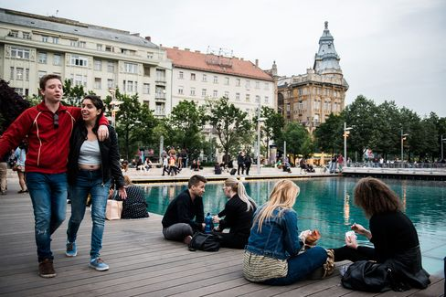 Visitors sit at the waterside in the 5th district of Budapest, Hungary, on May 15.