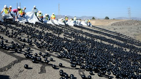 The final 20,000 black shade balls are released during a news conference at the LA Reservoir on Aug. 10 in Sylmar, California.