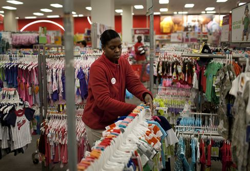 An employee re-stocks baby clothes at a Target Corp. store in the Brooklyn borough of New York. Photographer: Victor J. Blue/Bloomberg