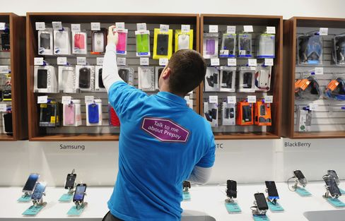 An Employee Works Inside an O2 Mobile Phone Store in Dublin