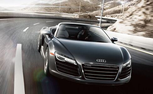 2014 Audi R8 V10 Spyder, black like Christian's heart.