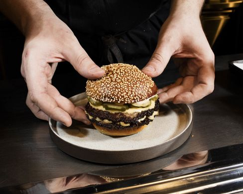 Assembling the signature dish at Salvation Burger.