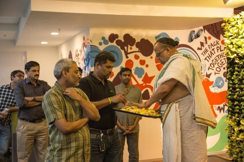 Freshdesk CEO Girish Mathrubootham (center) and a Hindu priest offering flowers in a ceremony to mark the opening of Freshdesk's new office in Chennai in January.
