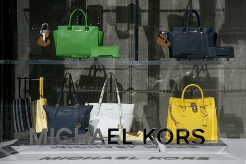 Handbags Sit on Display at a Michael Kors Store in Washington