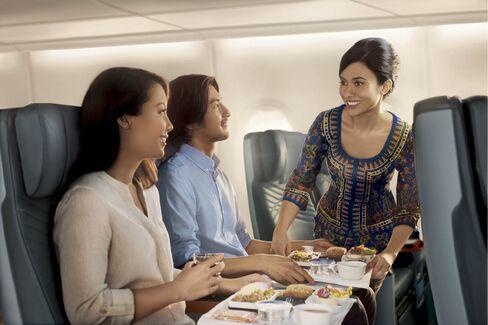 Meal service aboard Singapore's premium economy cabin.