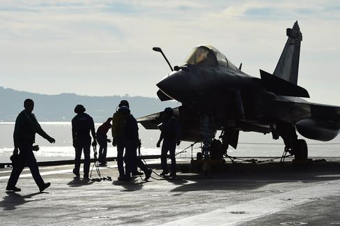 French naval tecnicians work on the flight deck of the aircraft carrier Charles-de-Gaulle