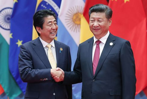 Shinzo Abe and Xi Jinping at the G20 Summit on Sept. 4