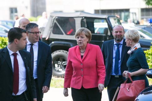 Chancellor Angela Merkel arrives at a CDU party meeting today