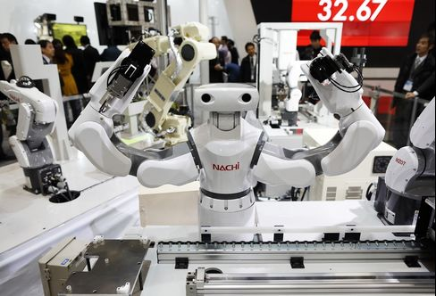 Anindustrial robot at the International Robot Exhibition 2015 in Tokyo.