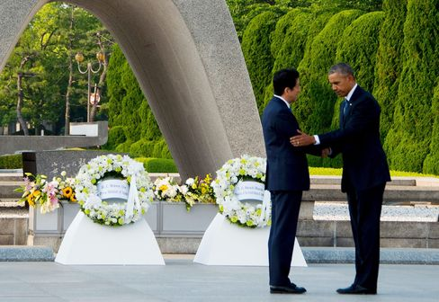 Obama and Abe shake hands at the Hiroshima Peace Memorial Park.
