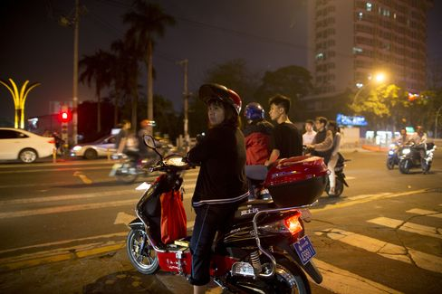 A Motorcyclist in Hainan Province