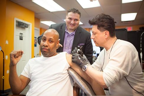 Q&A: A CEO Paying His Employees to Get Tattoos
