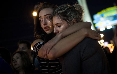 Mourners attend a candlelight vigil at the corner of Sahara Avenue and Las Vegas Boulevard for the victims of Sunday night's mass shooting, October 2, 2017 in Las Vegas.